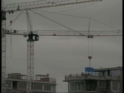 cranes rise above a construction site. - (war or terrorism or election or government or illness or news event or speech or politics or politician or conflict or military or extreme weather or business or economy) and not usa stock videos & royalty-free footage