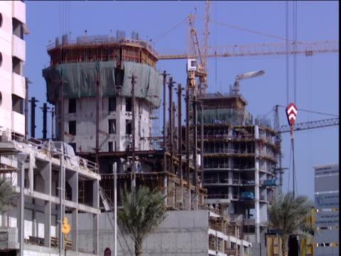 Cranes tower above large construction site Dubai