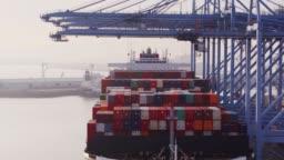 Cranes Unloading Cargo Ship - Drone Shot