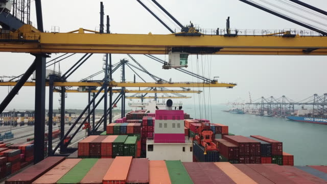 cranes unloading cargo ship - container stock videos & royalty-free footage