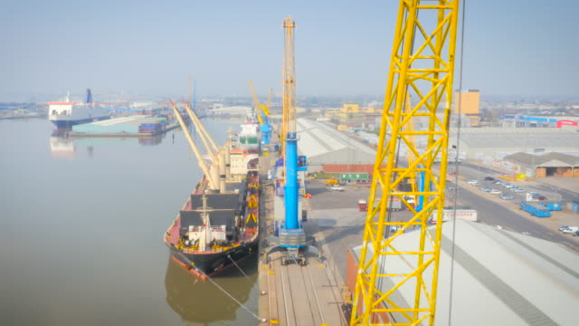 cranes unloading hull port, uk, filmed by drone - hull stock videos & royalty-free footage
