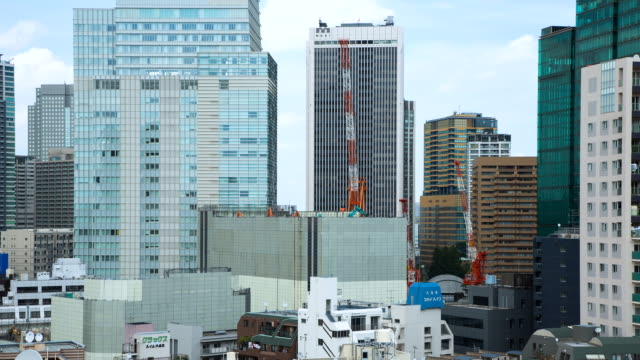 MS T/L Cranes working at construction site of new high-rise building / Tokyo, Japan