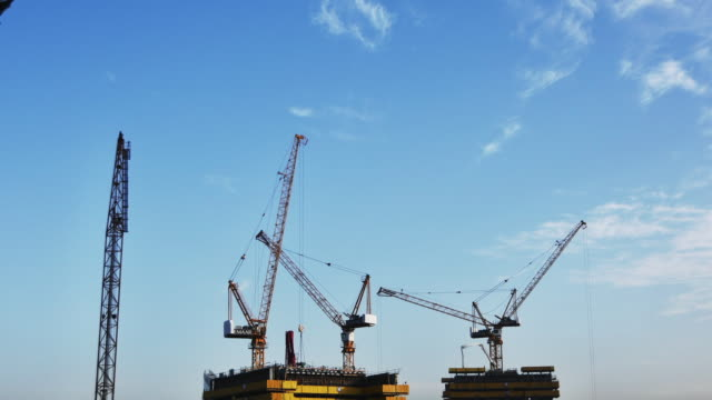 cranes working in dubai - construction site stock videos & royalty-free footage