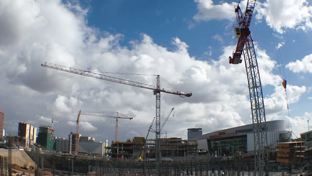 T/L WA Cranes working over construction site / Los Angeles, CA, USA