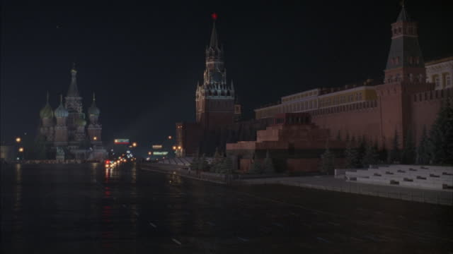 crane-shot of red square as a motorcade drives through the darkened city. - motorcade stock videos & royalty-free footage