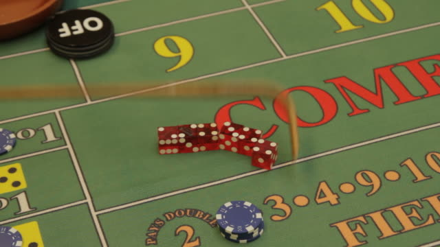 craps croupier pushing dice - craps stock videos & royalty-free footage