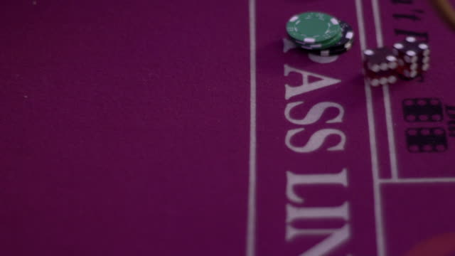 craps - picking up dice side view - craps stock videos & royalty-free footage