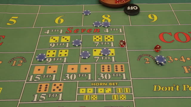 craps table - dice roll into shot and make three - casino worker stock videos and b-roll footage
