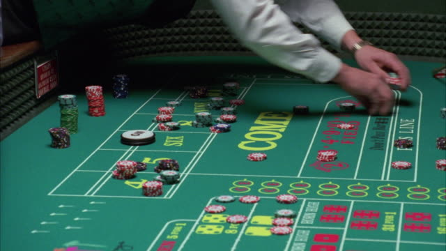 ms craps table gambling chips and dice are thrown and moved / las vegas, nevada, usa - craps stock videos & royalty-free footage