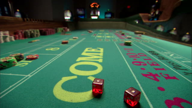 craps table in casino - dice stock videos & royalty-free footage