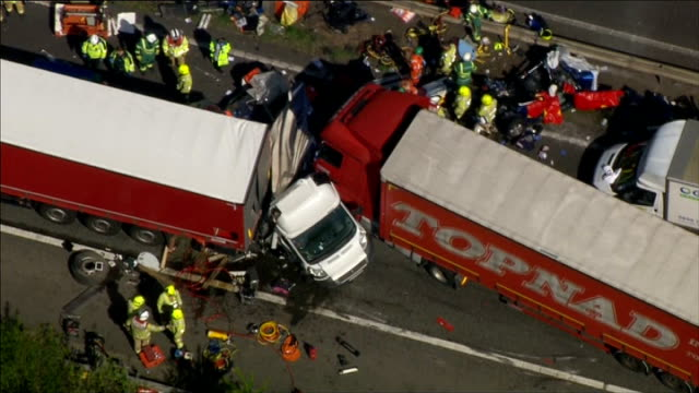 AIR VIEWs crash scene and traffic ENGLAND Kent M26 Motorway VIEWs queuing traffic on M26 Motorway helicopter and emergency vehicles at scene of crash...