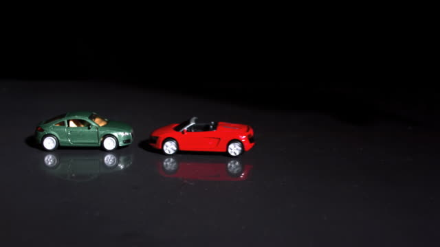 Crash between two toy cars in slow-motion