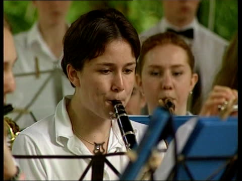 paris suffolk youth orchestra playing on bandstand cms girl playing clarinet cms girl playing french horn side ms three boys playing clarinets cms... - french horn stock videos and b-roll footage