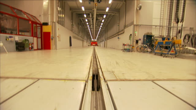 a crash test track stretches down a long hallway. - crash test stock videos & royalty-free footage
