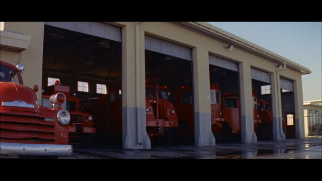 ms pan crash trucks getting out - fire station stock videos & royalty-free footage