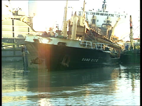 london river thames sand dredger 'sand kite' being towed away from thames barrier past 'sand kite' - itv weekend evening news stock-videos und b-roll-filmmaterial