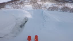 SLOW MOTION: Crashing in the untouched powder snow after doing a backflip.