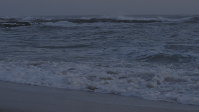 crashing waves on californian beach at twilight - audio available stock videos & royalty-free footage