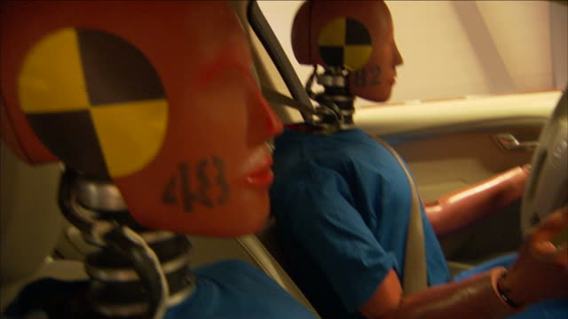 a crash-test dummy holds an atlas. - crash test stock videos & royalty-free footage