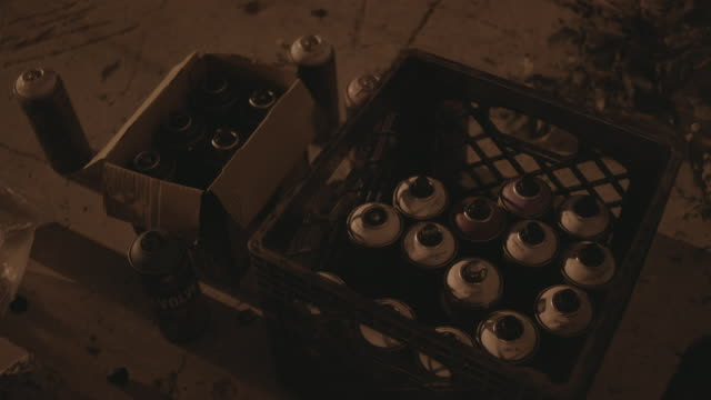 crate of spray paint cans for graffiti artists, close-up - spray painting stock videos & royalty-free footage