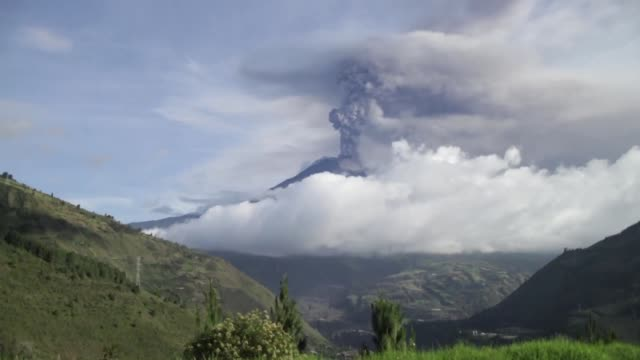 Crater from Tungurahua volcano expels gas, ash and rocks.
