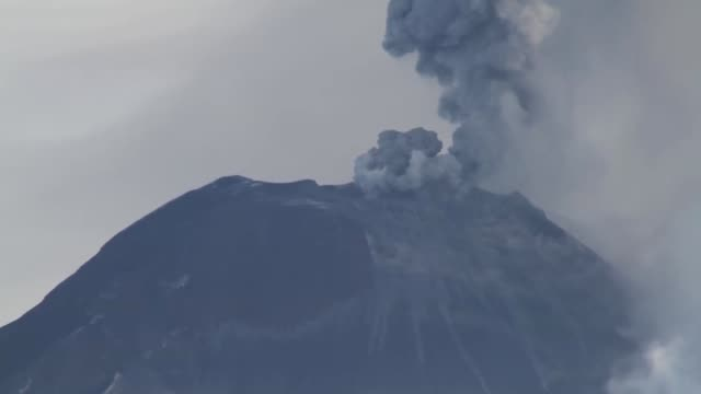 crater from tungurahua volcano expels gas, ash and rocks. - ecuador stock videos and b-roll footage