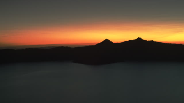 crater lake medium sunset - horizon over land stock videos & royalty-free footage