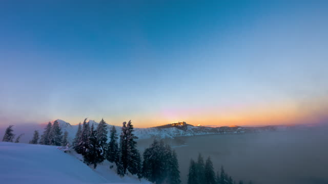 Crater Lake  National Park with snow storm at sunset