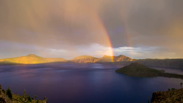 crater lake rainbow oregon - rainbow stock videos & royalty-free footage