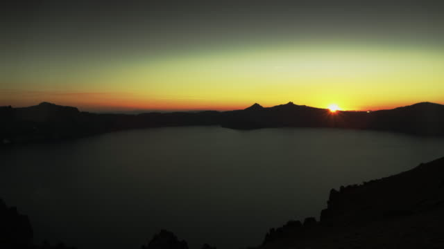 crater lake wide sunset - horizon over land stock videos & royalty-free footage