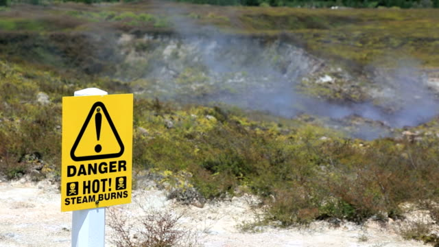 crater of the moon danger sign, rotorua, new zealand - rotorua stock videos and b-roll footage