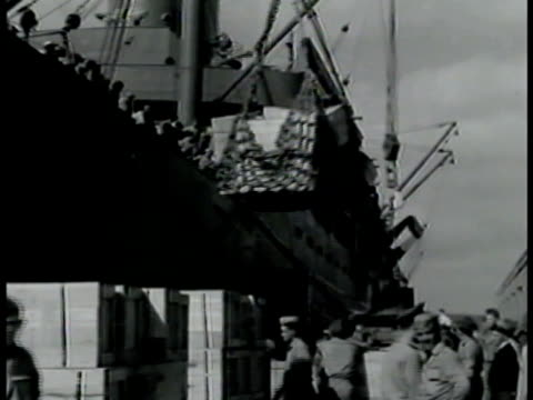 crates, cargo being lifted in net, dock, marines. soldiers carrying large bags on shoulder walking across gangplank. marines, on deck, ship sailing... - 1942 stock videos & royalty-free footage