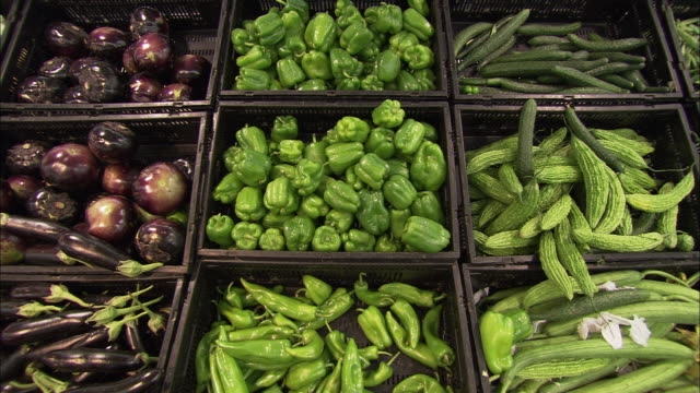 ms ha crates of eggplants, peppers and cucumbers in supermarket, beijing, china - pepper vegetable stock videos & royalty-free footage