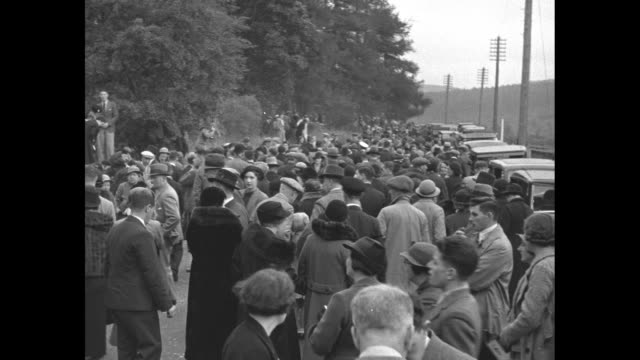 crathie kirk / car driving through crowds lining the road / prince albert duke of york duchess of york princess elizabeth princess margaret drive to... - princess elizabeth stock videos and b-roll footage