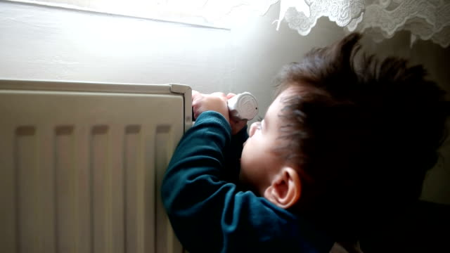 Crawling baby and heater