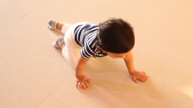 crawling baby boy playing with toys - crawling stock videos & royalty-free footage