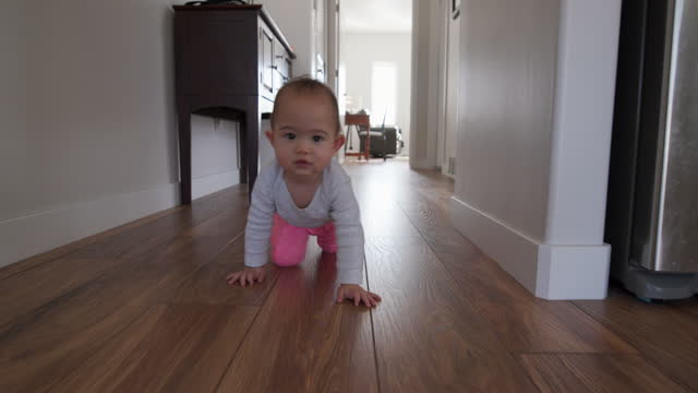 crawling baby - wooden floor stock videos & royalty-free footage