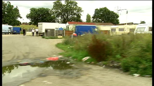 crays hill travellers' site families protest against eviction plans crays hill shot past caravans on dale farm site occupied by travellers - tracking shot stock videos & royalty-free footage