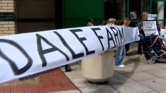 cray's hill travellers' site: inquiry begins; dale farm residents stand outside basildon council offices holding banners opposing bulldozing of site... - basildon stock videos & royalty-free footage