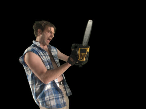 crazy chainsaw guy - this clip has an embedded alpha-channel - pre matted stock-videos und b-roll-filmmaterial
