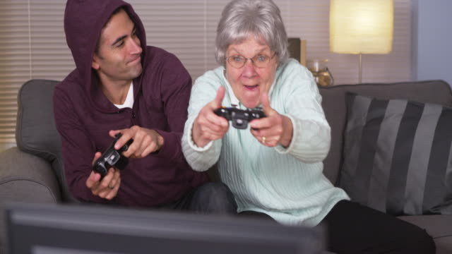 Crazy grandma beating her grandson at videogames