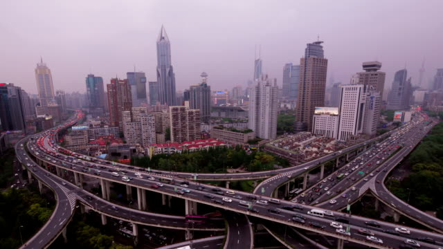 crazy highway intersection shanghai with skyline. day to night timelapse. - bottle opener stock videos & royalty-free footage