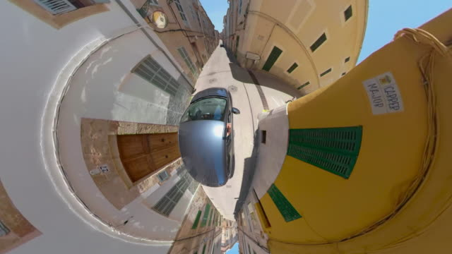 crazy little planet car driving through the alleys of small town arta on the spanish balearic iceland of majorca - panoramic stock videos & royalty-free footage