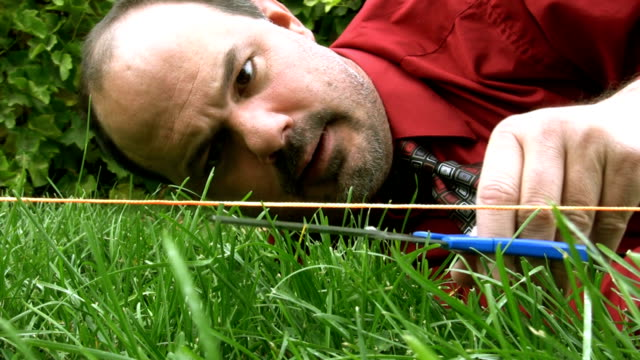crazy man cutting grass with scissors - lawn stock videos & royalty-free footage