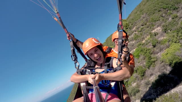 crazy paragliding flight above the beach - paragliding stock videos & royalty-free footage
