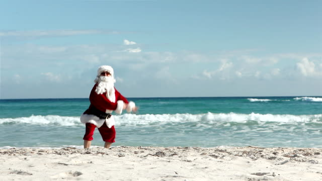 crazy santa beach - father christmas stock videos and b-roll footage