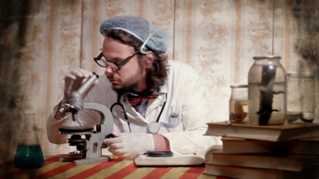 crazy scientist - looking through an object stock videos & royalty-free footage