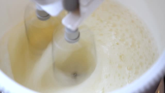 cream cake making with kneading machine - wire whisk stock videos and b-roll footage