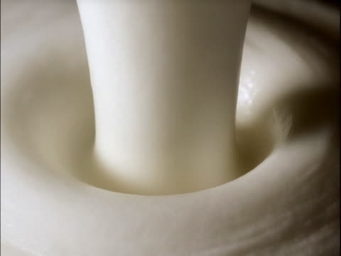 cream falling down. crema callendo - whipped cream stock videos & royalty-free footage