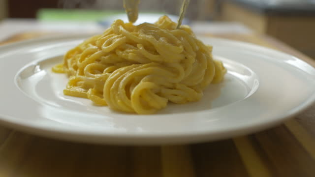 creamy butternut squash linguine with fried sage - spaghetti stock videos & royalty-free footage